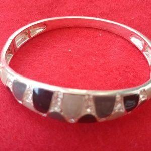 Multi-colored stone and silver bangle bracelet.